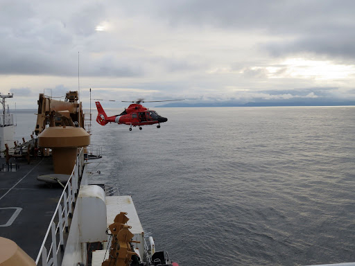 An MH-65 takes off from U.S. Coast Guard Cutter Healy during training operations